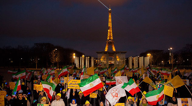 Crowds of protesters in front of the Iranian embassy in Paris, France.