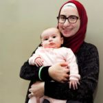Noura Al-Jizawi holds her 3-month-old daughter.