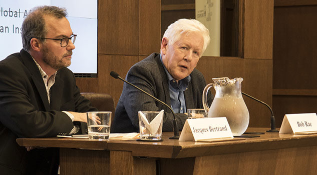 U of T Professor Jacques Bertrand (left) speaks with Bob Rae (right) about his report on the Rohingya crisis at the Munk School of Global Affairs