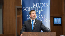 Prime Minister Juri Ratas speaks to a packed crowd at the Munk School of Global Affairs