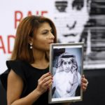 Ensaf Haidar, wife of the jailed Saudi Arabian blogger Raif Badawi, shows a portrait of her husband as he is awarded the Sakharov Prize, in Strasbourg, France.