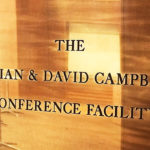 A plaque that reads The Vivian and David Campbell Conference Facility