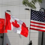 Flags of the U.S., Canada and Mexico fly next to each other in Detroit, Michigan, U.S.