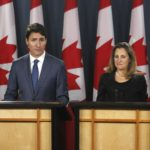 Justin Trudeau and Chrystia Freeland speaking at a press conference to announce new trade deal
