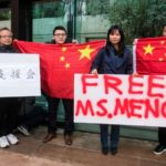 Protesters in China hold up signs calling for the release of Huawei executive Meng Wanzhou