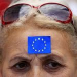 A woman attends a demonstration against Hungarian Prime Minister Viktor Orban in Budapes