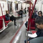 Commuters in a TTC subway car