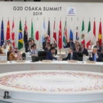 Leaders from G20 countries sitting together in two rows