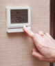 Finger on house thermometer