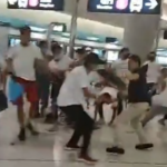 Blurry photo of a group of men fighting