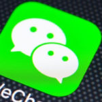The WeChat icon appears on a cell phone screen