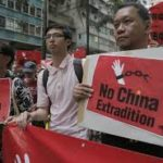 Activists holding anti-extradition signage