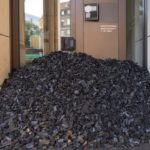 A pile of coal blocks the entrance to the Swiss bank UBS