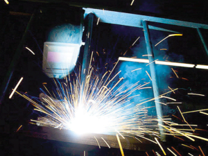A steelworker working in a factory