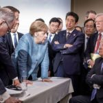 French President Emmanuel Macron, German Chancellor Angela Merkel, Prime Minister Shinzo Abe, and President Donald Trump at the G-& meeting in June, 2018.