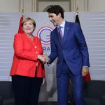 Justin Trudeau and Angela Merkel shake hands at the G20 summit in France