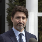 Justin Trudeau gives an update on COVID-19 at a press conference outside of his residence