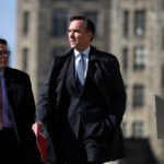 Finance Minister Bill Morneau heads to a press conference