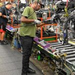 People working in a manufacturing plant