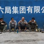 Migrant workers eat lunch outside a Beijing construction site in 2019.