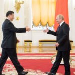 Xi and Putin shake hands in Moscow, June 2019