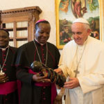 Bishop Alowonou (Center left) visits Pope Francis in Rome in 2015.