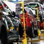 Cars on an assembly line