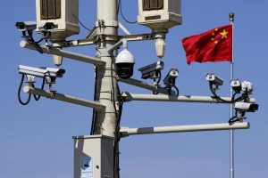 A Chinese flag flies between several security cameras