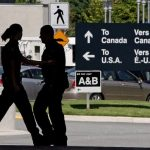 Canadian border guards at the Douglas border crossing on the Canada-U.S. border in Surrey, B.C. Article content