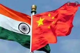 India and China flags fly side by side
