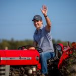 Justin Trudeau driving a tractor