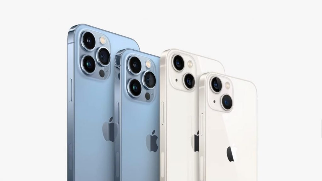 iPhone 13s standing side-by-side in blue and white